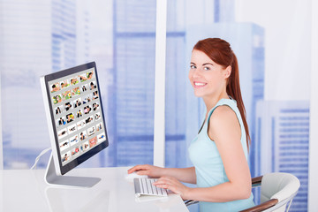 Businesswoman Browsing Pictures On Computer
