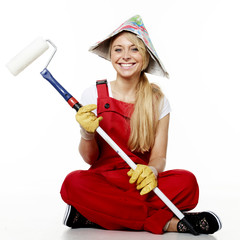 Woman with paint roller is renovating