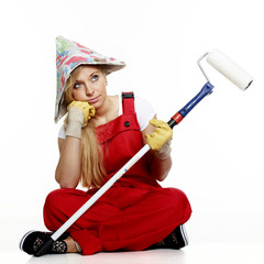 Woman with paint roller in a bad mood