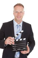 Businessman Holding Clapperboard