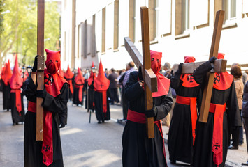 Nazarenos carrying crosses in the Holy Week