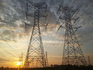 Pylon high voltage power lime in sunset