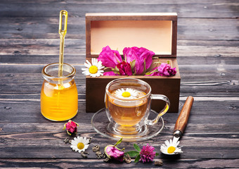 Herbal tea with honey and flowers. Wild herbs and flowers.