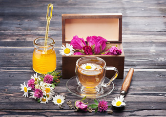 Herbal tea with honey and flowers. Flowers tea.