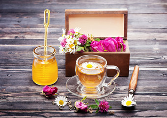 Herbal tea with honey and flowers. Wild herbs and flowers..