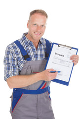 Handyman Showing Invoice On Clipboard