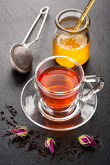 Herbal tea with rose flowers and honey.