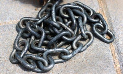 Closeup of chains on the floor
