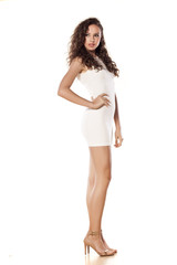 pretty girl in a short white dress on a white background