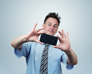 Businessman photographs smartphone