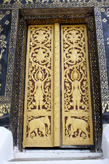 Sculpture and pattern of temple door in Laos