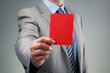 Businessman showing the red card - 66791650