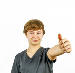 Teenage boy smiling showing thumbs up sign
