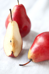 Red Forelle pears, one cut