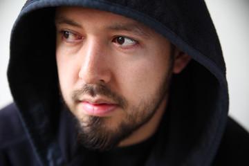 Young man in dark hoodie
