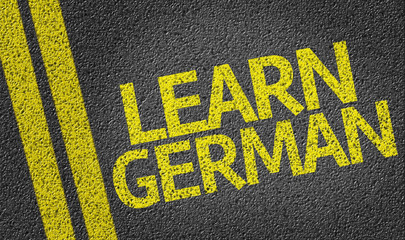 Learn German written on the road