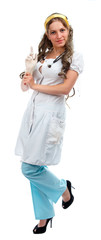 Young pretty nurse standing isolated