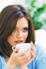 Young woman coffee portrait.
