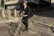 Leinwanddruck Bild - Businessman cycling to work