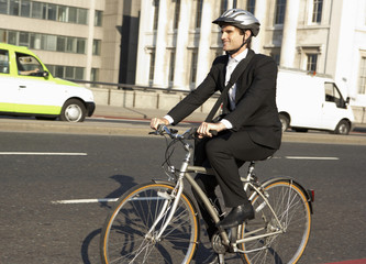 Businessman cycling to work