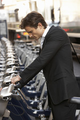 Businessman using hire bike