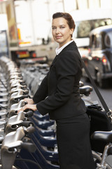 Businesswoman using hire bike