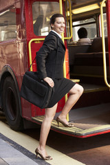 Businesswoman boarding Routemaster bus