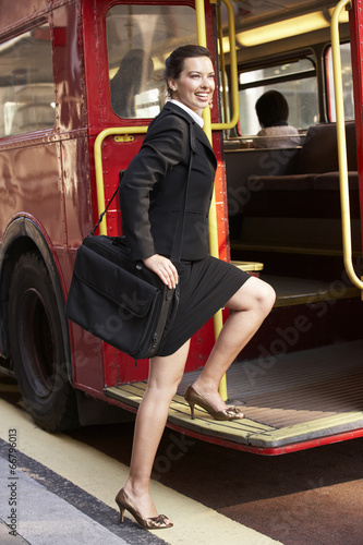 Businesswoman boarding Routemaster bus Poster