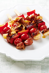 Barbecued Vegetable and Meat Kebabs on a Plate