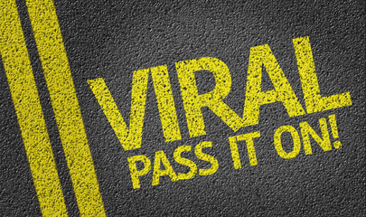 Viral, Pass It On! written on the road