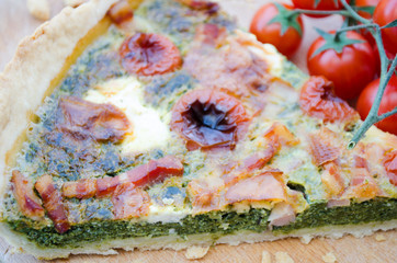 Spinach tart with cheese,bacon and tomatoes.