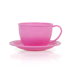 pink plastic toy cup and saucer