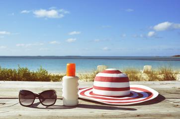 Sun lotion and sunglasses