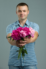 Man giving bouquet of flowers.