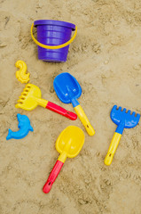 Toys in the sand - shovel, stencils, rakes | vertically