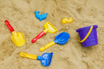Toys in the sand - shovel, stencils, rakes