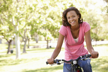 Young  woman cycling in park