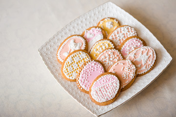Styled wedding cookies at white table