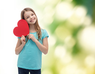 smiling little girl with red heart