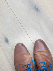 shoes against a wooden floor