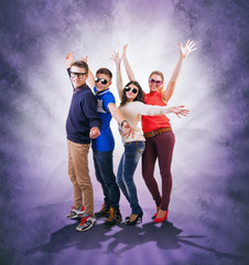 Dancing teenage friends on abstract grunge background
