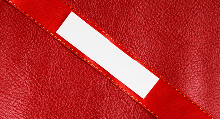 Piece scrap paper blank copy space on red leather background