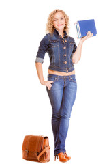 Denim fashion. Full length student girl in blue jeans bag books