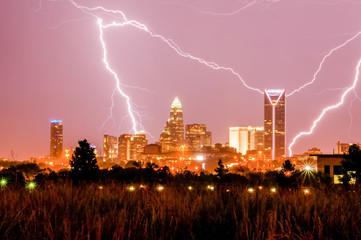 thunderstorm lightning strikes over charlotte city skyline in no