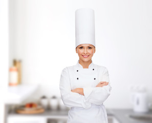 smiling female chef with crossed arms