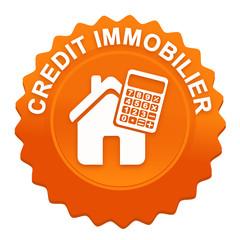 crédit immobilier sur bouton web denté orange