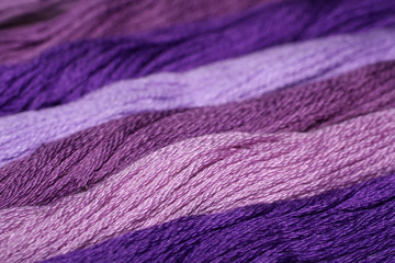 background of purple thread embroidery floss