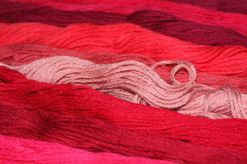 background of red thread embroidery floss