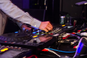 Dj mixing in night club