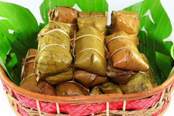 sticky rice covered in banana leaf
